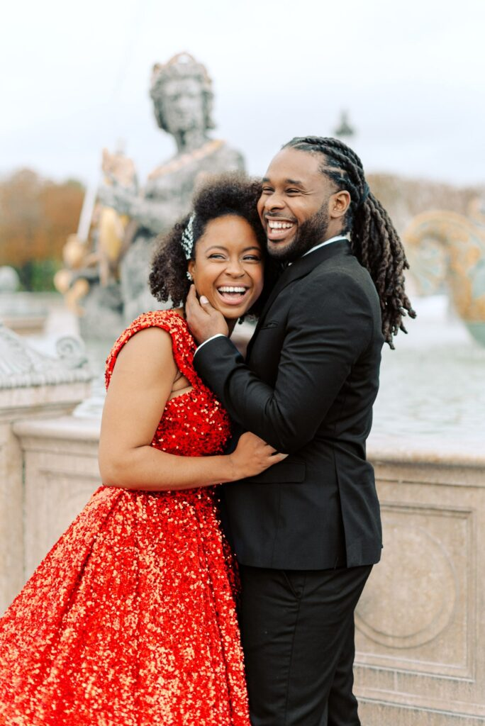 smiling couple at engagement session in paris