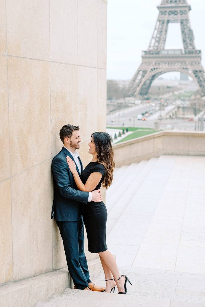 couple in front of the eiffel tower after surprise proposal in paris