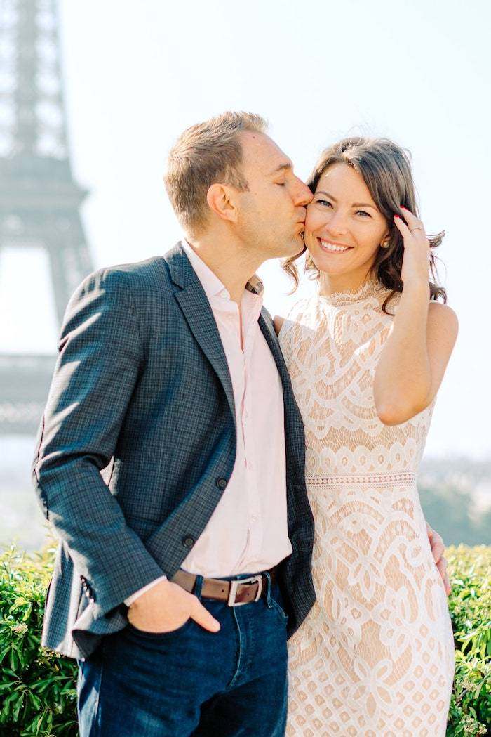 couple at the eiffel tower in paris for engagement session