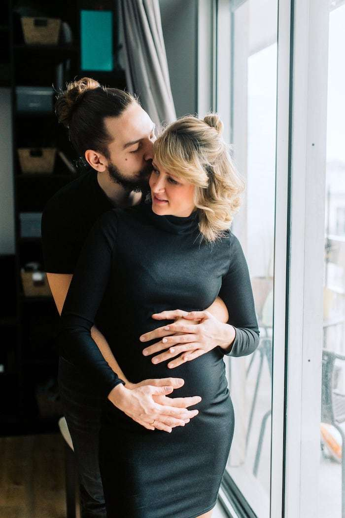 happy couple during maternity photo shoot in paris