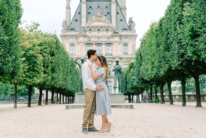 couple in front of the louvre after surprise proposal